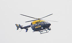 © Licensed to London News Pictures. 19/03/2017. London, UK. A police helicopter watches Anti-terror Police board a tourist boat, taken hostage by people playing armed terrorists, in an ant-terror training exercise takes place on The River Thames in  London. It is the first time that an exercise of this type has taken place on the river. Photo credit: Ben Cawthra/LNP