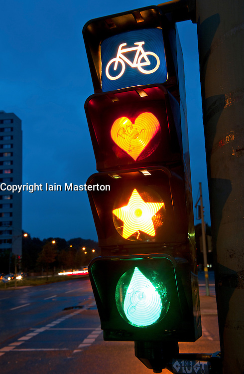 Detail of cyclist traffic lights with lamps painted to show heart, star and tear in Berlin Germany