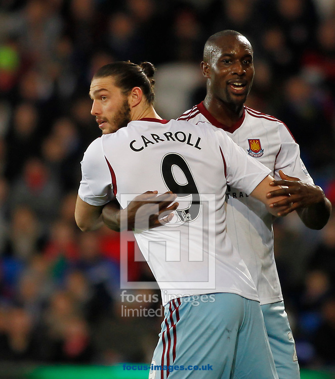 Picture by Mike  Griffiths/Focus Images Ltd +44 7766 223933<br /> 11/01/2014<br /> Andy Carroll and Carlton Cole of West Ham United during the Barclays Premier League match at the Cardiff City Stadium, Cardiff.