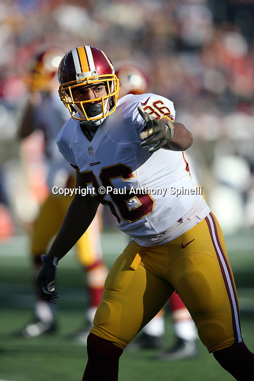 Washington Redskins tight end Jordan Reed (86) points to his left as he gets set to go out for a pass during the 2015 week 9 regular season NFL football game against the New England Patriots on Sunday, Nov. 8, 2015 in Foxborough, Mass. The Patriots won the game 27-10. (©Paul Anthony Spinelli)