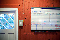 29 December, 2009. Bronxville, NY. An exercise log board is here at the entrance of the garage of his home office where he exercises 5 hours every day. Francesco  Clark, 30, is the founder and president of Clark's Botanicals. Francesco Clark suffers a crippling cord injury due to a swimming pool diving accident on June 1, 2002. Clark's Botanicals was born out of the tragedy.<br /> With his central nervous system impaired, Francesco, who was then an assistant stylist at Harper's Bazar, lost the ability not only to walk, but even to sweat. This led to clogged pores and chronic breakouts. When neither over-the-counter nor prescriptive remedies worked, he turned to his father, Dr. Harold Clark, a physician trained in both traditional Western medicine and homeopathy.<br /> <br /> Together they developed botanically-based formulas that effectively rebalanced Francesco's skin, clearing it up entirely. Through word-of-mouth, other people discovered and fell in love with these products, and in 2005, Francesco began selling Clark's Botanicals on his website.<br /> ©2009 Gianni Cipriano for The New York Times<br /> cell. +1 646 465 2168 (USA)<br /> cell. +1 328 567 7923 (Italy)<br /> gianni@giannicipriano.com<br /> www.giannicipriano.com