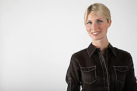Young businesswoman on white background portrait