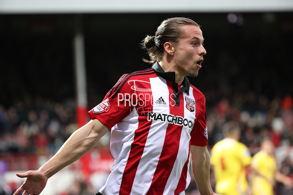 Brentford striker Lasse Vibe scoring the first goal to make the score 1-0 during the Sky Bet Championship match between Brentford and Milton Keynes Dons at Griffin Park, London, England on 5 December 2015. Photo by Matthew Redman.