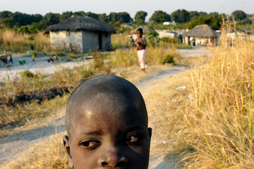 A young boy in Luanga 1 village, an area cleared of landmines by Mines Advisory Group (MAG), to allow the resettlement of returning refugees after decades of civil war..Luau, Moxico Province, Angola. 25/07/2008..Photo © J.B. Russell