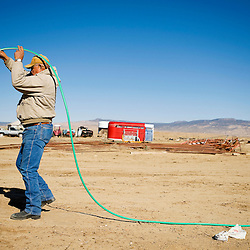 031412       Brian Leddy.Herman Plummer, 62, drains water from a hose while working at his ranch in Coyote Canyon Wednesday. While the area has been blessed with an artesian well that has always provided abundant water for horses and livestock, Plummer said he's seen a decrease in water levels in recent years.
