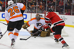 Jan 21; Newark, NJ, USA; Philadelphia Flyers goalie Ilya Bryzgalov (30) makes a save on New Jersey Devils center Brad Mills (11) during the first period at the Prudential Center.