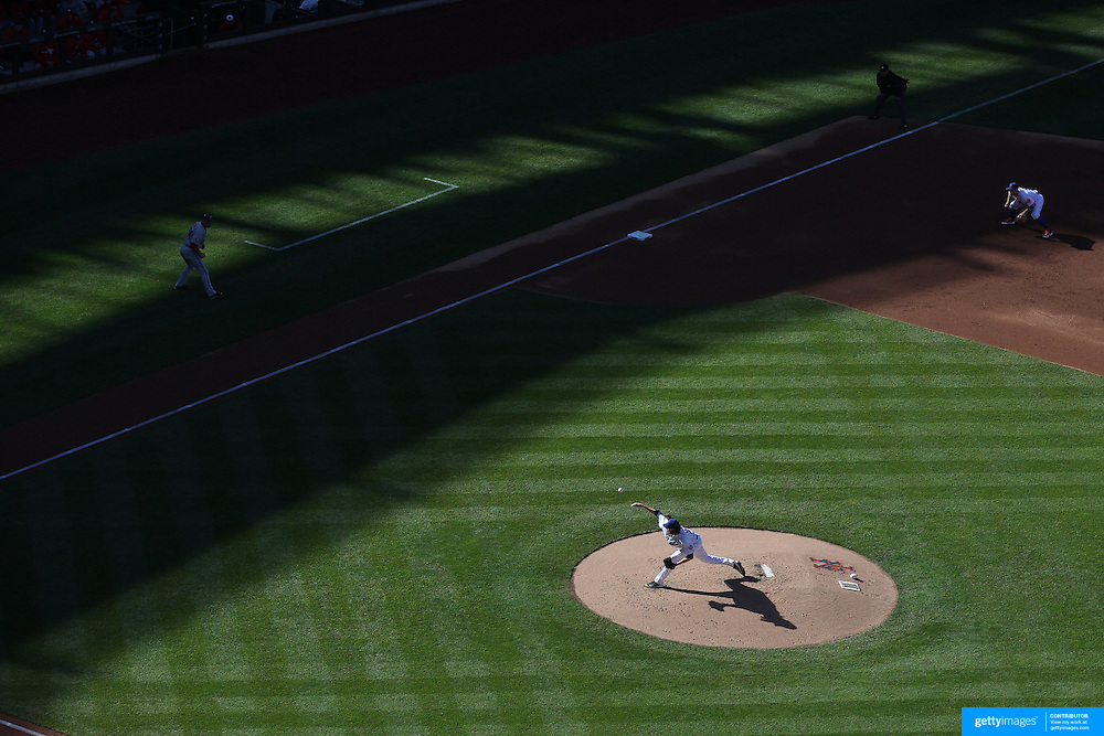 Pitcher Jacob deGrom, New York Mets, pitching in the late afternoon light during the New York Mets Vs Washington Nationals MLB regular season baseball game at Citi Field, Queens, New York. USA. 4th October 2015. Photo Tim Clayton