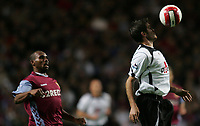 Photo: Lee Earle.<br /> Aston Villa v Fulham. The Barclays Premiership. 21/10/2006. Fulham's Frank Queudrue (R) controls the ball as Didier Agathe looks on.