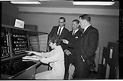 Official Opening of I.C.T.House..1963..01.10.1963..10.01.1963..1st October 1963..Dr James Ryan TD, Minister for Finance,officially opened I.C.T. House ,Adelaide Road, Dublin, for international Computers and Tabulators Ltd. The company had staff working in several sites around the city and the new premises will bring all of them together under the one roof...Image shows Ms K Corcoran showing the invited guests.the operation of a computer console in ICT House.