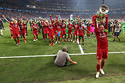CHAMPIONS Liverpool midfielder James Milner (7) lifts the Champions League Trophy after the UEFA Champions League Final match between Tottenham Hotspur and Liverpool at Wanda Metropolitano Stadium, Madrid, Spain on 1 June 2019.