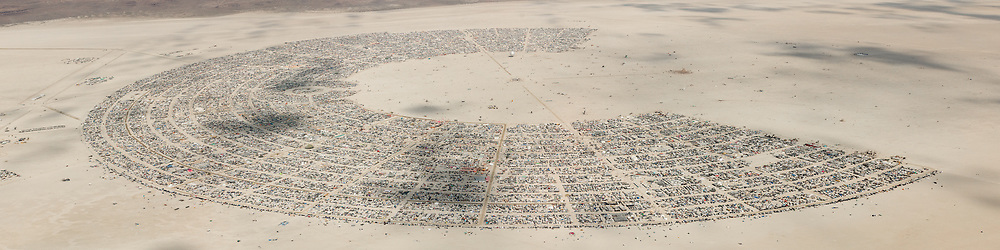 This aerial photograph of Black Rock City was shot on the morning of Friday August 31st, 2018 during Burning Man 2018. The pilot of the aircraft was Purple Haze. This image is about 115 Megapixels.