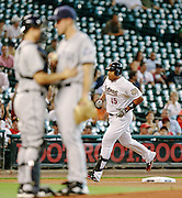June 25, 2012; Houston, TX, USA; Houston Astros first baseman Carlos Lee (45) rounds third after hitting a solo home run against San Diego Padres starting pitcher Ross Ohlendorf (59) during the first inning at Minute Maid Park. Mandatory Credit: Thomas Campbell-US PRESSWIRE