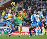 Photo. Andrew Unwin, Digitalsport<br /> Blackburn Rovers v Norwich, Barclays Premiership, Ewood Park, Blackburn 12/02/2005.<br /> Norwich's Dean Ashton (C) battles for the ball with Blackburn's Aaron Mokoena (R).
