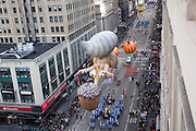 Balloons go down 6th Avenue for the 89th annual Macy's Thanksgiving Day Parade as seen from above street level on Thursday, Nov. 26, 2015, in New York. (Photo by Ben Hider/Invision/AP)
