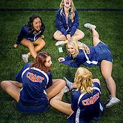 Orange Coast College Cheerleaders stretch during warm up at a football game between Orange Coast College and Golden West College at LeBard stadium in Costa Mesa, CA on Saturday, November 8 2015. (Dotan Saguy / SSA)