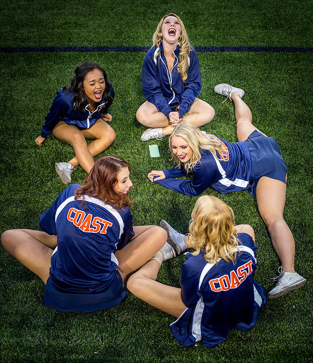 Orange Coast College Cheerleaders stretch during warm up at a football game between Orange Coast College and Golden West College at LeBard stadium in Costa Mesa, CA on Saturday, November 8 2015. (Dotan Saguy / SSA)