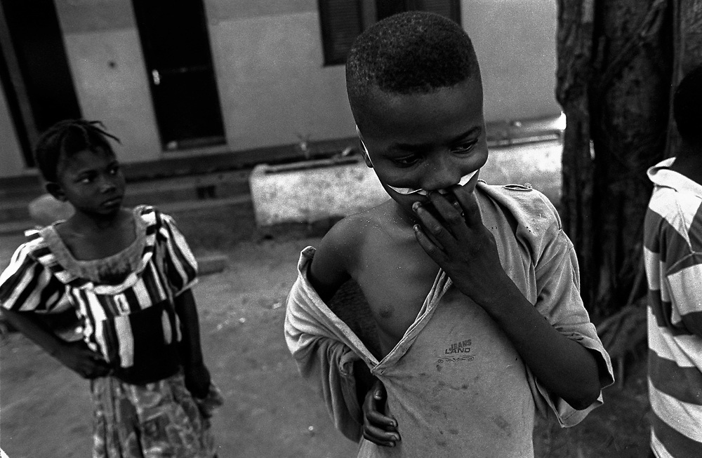 St. Michaels, Lakka, Sierra Leone. April 1999..16 year old ex-soldier Augustine Sandi is severely traumatised. He was abducted from his village in the south. Lakka was once a holiday resort for upper class French tourists and now serves as a rehabilitation centre for boy soldiers of the civil war in Sierra Leone.