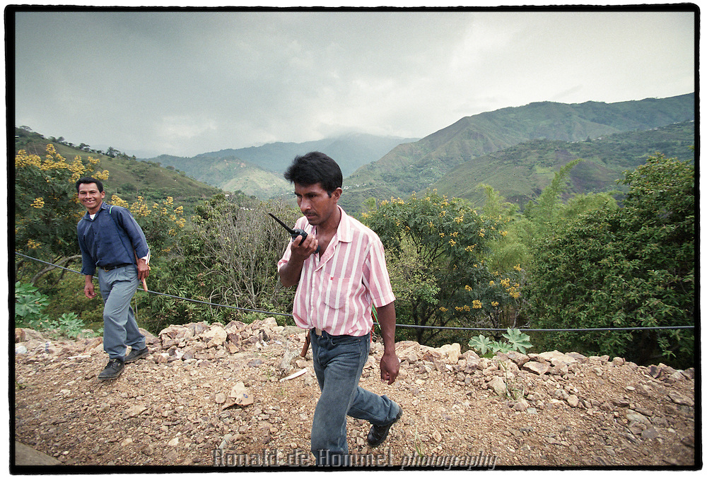 Two members of the guardia Indigena, a civil guard in the mountains of the Colombian southern province of Cauca on partol in the Toribio area. The guards try to keep a precarious balance amongst the fighting parties in the region: paramilitaries, FARC guerrilla and the government troops., 2003 Cauca province, southern Colombia