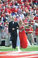Senior maid McKenzie Lowery (right) is escorted by Ole Miss pole vaulter Sam Kendricks at Ole Miss vs. Auburn at Vaught-Hemingway Stadium in Oxford, Miss. on Saturday, October 13, 2012.