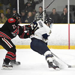TORONTO, ON  - APR 10,  2018: Ontario Junior Hockey League, South West Conference Championship Series. Game seven of the best of seven series between Georgetown Raiders and the Toronto Patriots. Austin Cho #20 of the Georgetown Raiders tries to keep the puck from Michael Boushy #91 of the Toronto Patriots during the first period.<br /> (Photo by Andy Corneau / OJHL Images)