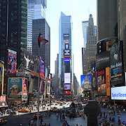 A panoramic view of Time Square, New York. Times Square is the major commercial intersection in Midtown Manhattan, New York City, at the junction of Broadway and Seventh Avenue and stretching from West 42nd to West 47th Streets. Time Square, New York, USA. 27th April 2012. Photo Tim Clayton.Note to Editors. This image is a composite of three images taken a split second apart and merged in editing.