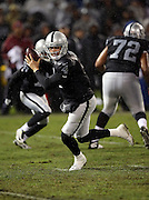 Oakland Raiders quarterback Derek Carr (4) scrambles during the NFL week 12 regular season football game against the Kansas City Chiefs on Thursday, Nov. 20, 2014 in Oakland, Calif. The Raiders won their first game of the season 24-20. ©Paul Anthony Spinelli