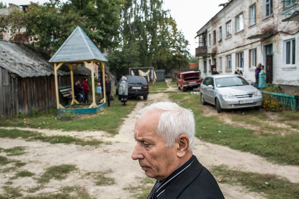 SEMYONOVKA, UKRAINE - SEPTEMBER 13, 2015: Ivan M. Papchenko, 67, secretary of the local Communist party, outside the building that houses the party's office in Semyonovka, Ukraine. A statue of Vladimir I. Lenin, which was taken down from the town square in the immediate aftermath of the collapse of the government of President Viktor Yanukovych in February 2014, was erected again in a new, more discreet, location two months later based in part by a petition to the city council submitted by the local Communist party. A new decommunization law has stirred criticism as being a diversion from more pressing issues of war and the economy. CREDIT: Brendan Hoffman for The New York Times