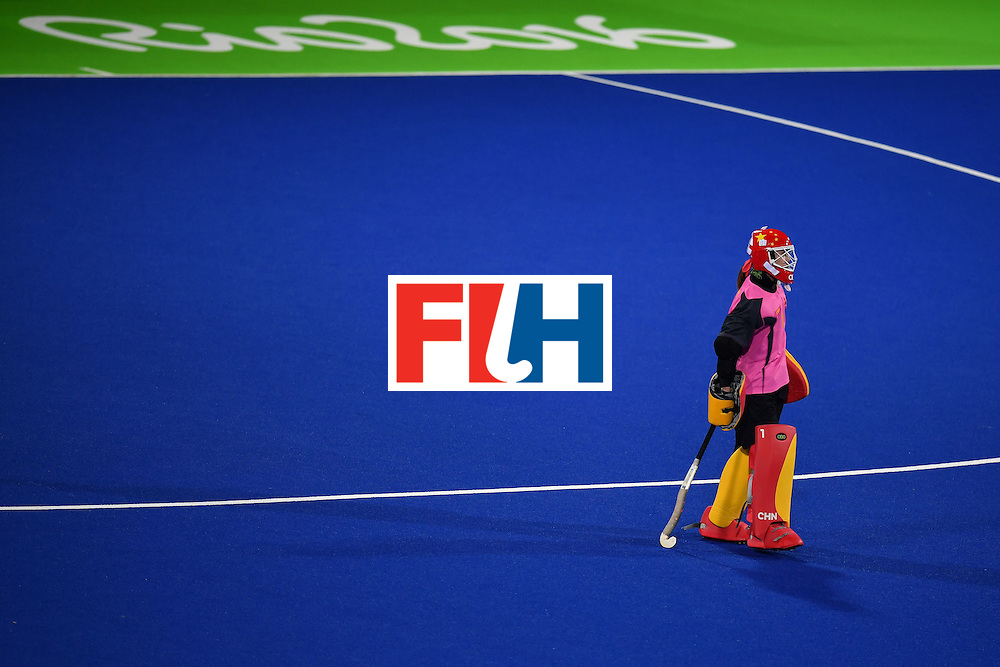China's goalkeeeper Li Dongxiao walks on the pitch during the women's field hockey China vs New Zealand match of the Rio 2016 Olympics Games at the Olympic Hockey Centre in Rio de Janeiro on August, 13 2016. / AFP / MANAN VATSYAYANA        (Photo credit should read MANAN VATSYAYANA/AFP/Getty Images)