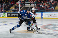KELOWNA, BC - JANUARY 8: Jacob Herauf #2 of the Victoria Royals is checked by Michael Farren #16 of the Kelowna Rockets at Prospera Place on January 8, 2020 in Kelowna, Canada. (Photo by Marissa Baecker/Shoot the Breeze)