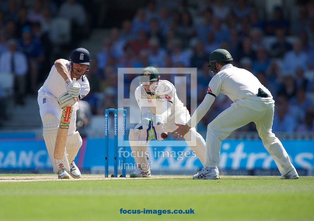 Captain Alastair Cook of England batting and wicketkeeper Peter Nevill of Australia during the 5th Investec Ashes Test Match match at the Kia Oval, London<br /> Picture by Alan Stanford/Focus Images Ltd +44 7915 056117<br /> 22/08/2015