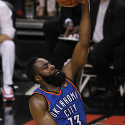 Jun 21, 2012; Miami, FL, USA; Oklahoma City Thunder guard James Harden (13) drives to the basket against the Miami Heat during the third quarter in game five in the 2012 NBA Finals at the American Airlines Arena. Mandatory Credit: Derick E. Hingle-US PRESSWIRE