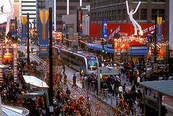 Metro light rail train running down Main Street in downtown Houston at Christmas