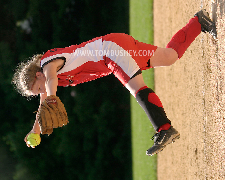 A pitcher winds up during the Independence Blast 12 and under girls' softball tournament at Watts Park in Middletown, N.Y., July 9, 2005.