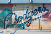LOS ANGELES - MAY 30:  A Dodgers logo is painted on a wall outside the stadium for the game between the Colorado Rockies and the Los Angeles Dodgers on Monday, May 30, 2011 at Dodger Stadium in Los Angeles, California. The Dodgers won the game 7-1. (Photo by Paul Spinelli/MLB Photos via Getty Images)