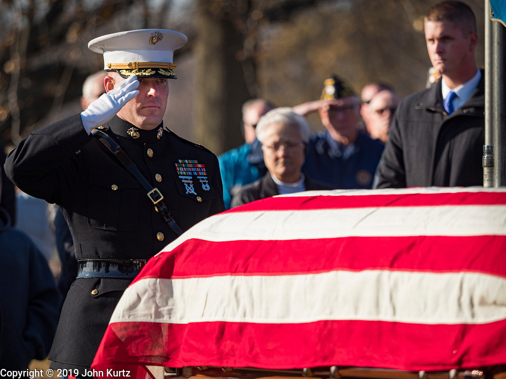 22 NOVEMBER 2019 - DES MOINES, IOWA: U.S. Marine Maj. JOHN SHECKELLS salutes the casket of US Marine Corps Reserve Private Channing Whitaker during Whitaker's reinterment service. Whitaker died in the Battle of Tarawa on Nov. 22, 1943. He was buried on Betio Island, in the Gilbert Islands, and his remains were recovered in March 2019. He was identified by a DNA match with surviving family members in Iowa. Whitaker was reintered in the Glendale Cemetery in Des Moines exactly 76 years after his death in World War Two. About 1,000 US Marines and sailers were killed in four days during the Battle of Tarawa.           PHOTO BY JACK KURTZ