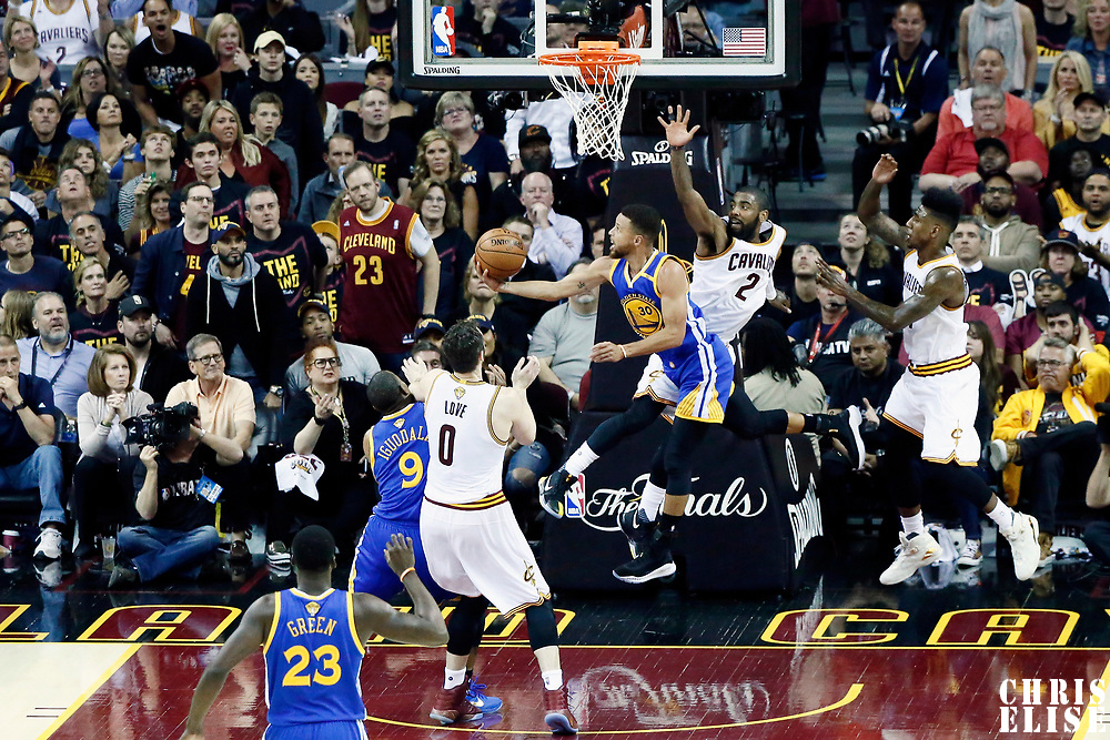 07 June 2017: Golden State Warriors guard Stephen Curry (30) goes for the reverse layup past Cleveland Cavaliers guard Kyrie Irving (2) during the Golden State Warriors 118-113 victory over the Cleveland Cavaliers, in game 3 of the 2017 NBA Finals, at  the Quicken Loans Arena, Cleveland, Ohio, USA.
