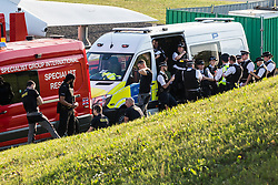 London, UK. 19th April, 2019. Police officers and a specialist rescue team alongside the main motorway approach to Heathrow airport. A large policing operation was put in place in and around the airport in preparation for expected protests by climate change activists from Extinction Rebellion. Only a very small symbolic protest by teenage activists from Extinction Rebellion Youth took place, dispersed by police officers under threat of arrest.
