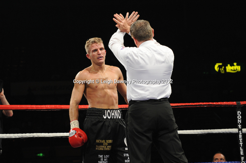 Lee Purdy defeats Chris Johnson for the English Welterweight Title at the Motorpoint Arena, Sheffield, United Kingdom on the 7th July 2012. Promoted by Matchroom Sport. ©Leigh Dawney Photography 2012.