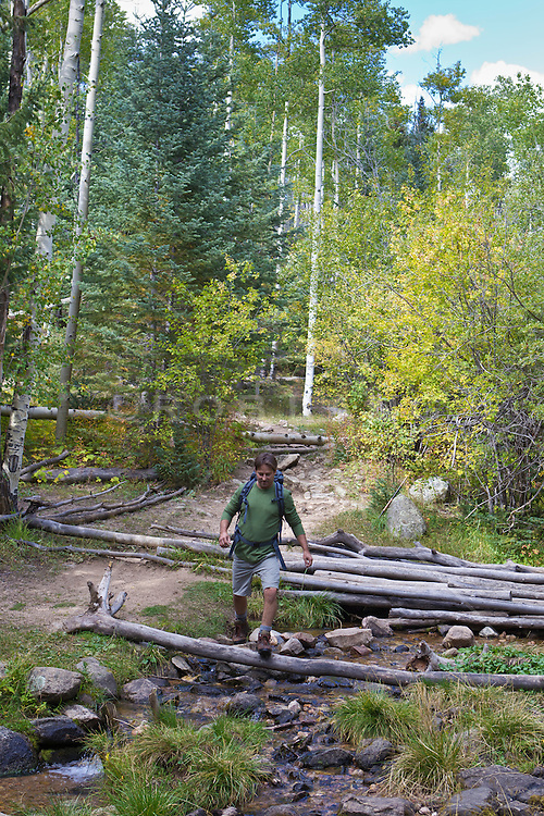 man hiking in the woods in Santa Fe, New Mexico