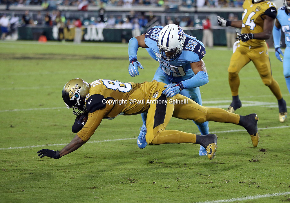 Jacksonville Jaguars tight end Julius Thomas (80) dives for yardage as he gets tackled after catching a pass by Tennessee Titans inside linebacker Wesley Woodyard (59) during the 2015 week 11 regular season NFL football game against the Tennessee Titans on Thursday, Nov. 19, 2015 in Jacksonville, Fla. The Jaguars won the game 19-13. (©Paul Anthony Spinelli)