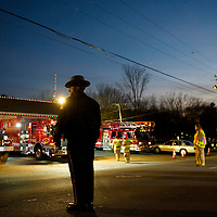 Policemen and firemen congregate outside the Sandy Hook Volunteer Fire Department a few hundred yards from the Sandy Hook Elementary School, the site of a mass shooting in Sandy Hook, CT on December 14, 2012.