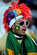 A Brazil supporter wearing a wig sings during the 2010 FIFA World Cup South Africa Group G match between Brazil and North Korea at Ellis Park Stadium on June 15, 2010 in Johannesburg, South Africa.