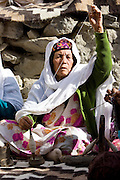 Woman spins wool in mountain village of Altit in Hunza region of Karokoram Mountains, Pakistan