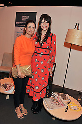 Left to right, LIVIA FIRTH and DAISY LOWE at the Graduate Fashion Week Gala drinks reception held at Earls Court 2, London on 13th June 2012.
