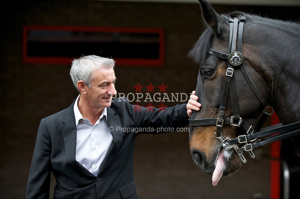 LIVERPOOL, ENGLAND - Monday, April 4, 2011: Liverpool's legendary number nine Ian Rush pictured with Jaguar the Merseyside Police Horse Number Nine. Jaguar will be leading the winning horse to the winner's circle on Saturday at the John Smith's Aintree Grand National. (Photo by David Rawcliffe/Propaganda)