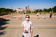 01 AUGUST 2020 - DES MOINES, IOWA: AARON HAHN watches doctors gather at the Iowa State Capitol Saturday. Hahn's wife is a MD. About 50 doctors, medical professionals, and public health professionals from across Iowa came to the State Capitol to demand that Iowa Governor Kim Reynolds impose a mask mandate to control the spread of the coronavirus (SARS-CoV-2). Despite the continued spread of the coronavirus and rapidly increasing infection rate for COVID-19, the Governor has refused to impose a mask mandate or close businesses. For the week ending Saturday, Aug. 1, Iowa reported new 2,736 new cases of COVID-19.             PHOTO BY JACK KURTZ