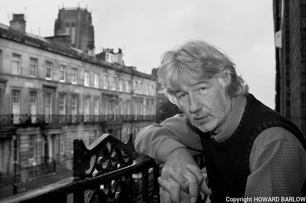 PIC BY HOWARD BARLOW..writer WILLY RUSSELL at his offices in Liverpool.