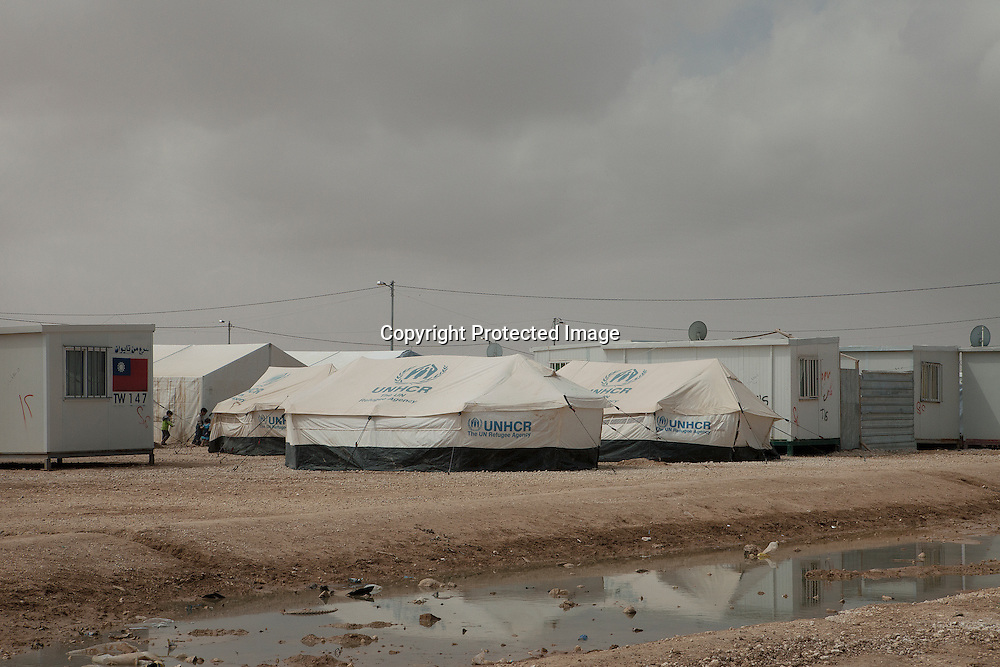 Tentes and containers surrounded by ditch-water in the second largest refugee camp - Zaatari Refugee Camp - home of over 100 thousand Syrian refugees located Mafraq, Jordan