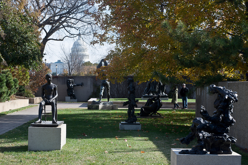 The Hirshhorn Museum Sculpture Garden features statues by Auguste Rodin, Botero and others and is situated on the National Mall in Washington, DC with views of the U.S. Capitol building and Washington monument (not pictured).