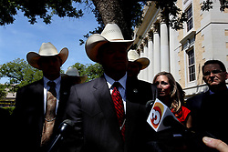 "Texas Rangers talk to the media after polygamist leader Warren Jeffs, who heads the Fundamentalist Church of Jesus Christ of Latter-Day Saints, was sentenced to life in prison for sexually assaulting two underage girls he claimed as ""spiritual"" brides. The Texas jury of ten women and two men deliberated for less than an hour before giving him a life sentence for one charge and 20 years for a second, the maximum sentence for both. San Angelo, Texas, Aug. 9, 2011."
